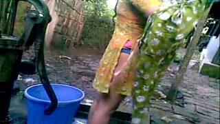 Awesome desi village beauty girl bathing outside
